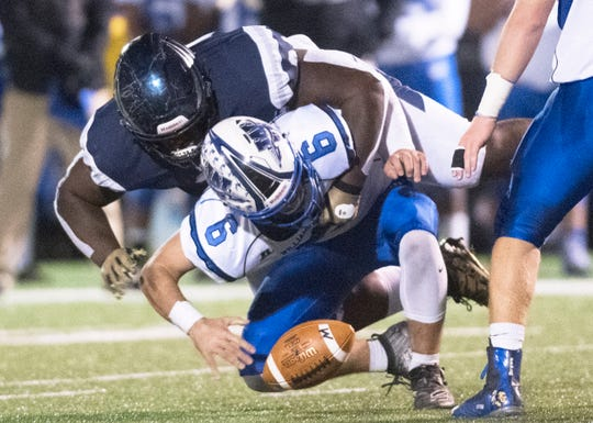St. Augustine Prep's Isaiah Raikes, top,  sacks Williamstown's Dougie Brown and forces a fumble during the 2nd quarter of the football game played at St. Augustine Prep on Friday, November 1, 2019.    St. Augustine Prep defeated Williamstown, 21-7.