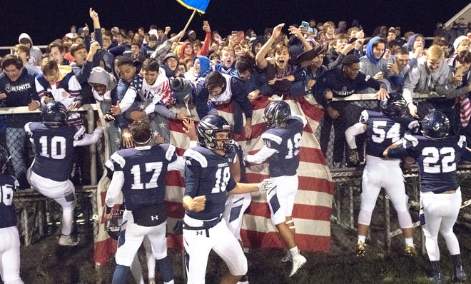 Members of the St. Augustine Prep football team celebrate with members of the St. Augustine Prep student section, known as the 'Richland Rowdies' after St. Augustine Prep defeated Williamstown, 21-7 at St. Augustine Prep on Friday, November 1, 2019.