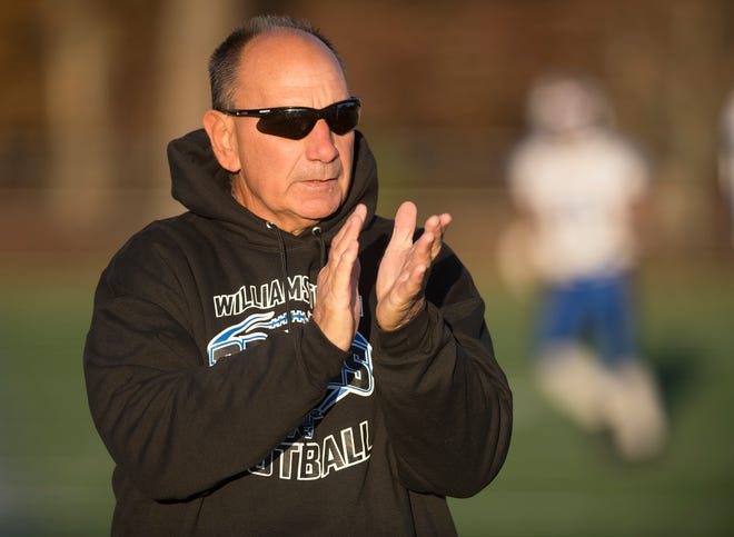 Williamstown High School football coach Frank Fucetola leads his players in warm up drills prior to the football game between Williamstown and St. Augustine Prep. played at St. Augustine Prep High School on Friday, November 1, 2019.  St. Augustine Prep defeated Williamstown, 21-7.