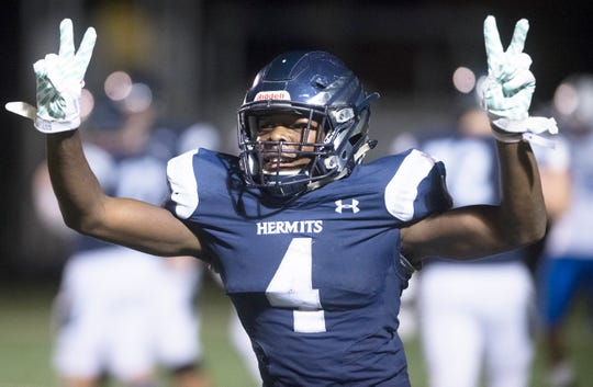 St. Augustine Prep's Nasir Hill celebrates after Hill made a 40-yard interception return for a touchdown during the 4th quarter of St. Augustine Prep's 21-7 victory over Williamstown on Friday, November 1, 2019 at St. Augustine Prep. High School.
