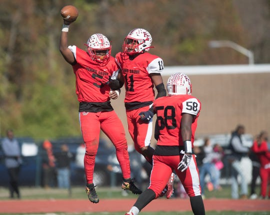 Penns Grove's Nasir Robinson, left, celebrates with Penns Grove's Torvon Ransome after Robinson scored a touchdown during the 4th quarter of Penns Grove's 27-21 win over Salem at Penns Grove High School on Saturday, November 2, 2019.