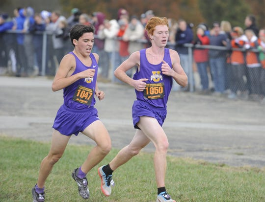 Unioto's Gabe Lynch (left) and Corey Schobelock (right) earned All-Ohio honors at the D-II boys state meet on Saturday. Unioto High School's cross country team finished second overall at the Division II OHSAA State Cross Country Championships on Nov. 2, 2019 at National Trail Raceway in Hebron, Ohio.