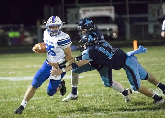 Southeastern quarterback Lane Ruby carries the ball during a 66-37 win over Adena. Ruby earned the D-VI All-District Offensive Player of the Year Award.