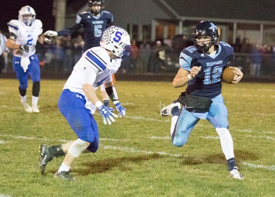 Adena's Preston Sykes runs the ball in a game against Southeastern on Nov. 1, 2019 in Frankfort, Ohio.