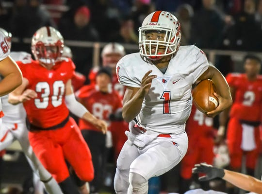 Freddie Johnson of the Colerain Cardinals runs the ball against the Fairfield Indians on Friday, Nov. 1, 2019 at Kroger Stadium in Fairfield, Ohio