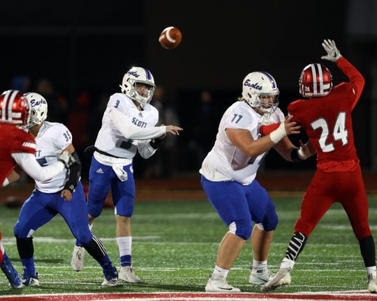 With lineman Jacob Randall providing the protection, Scott quarterback Gus Howlett attempts a pass in the game between Scott and Dixie Heights High Schools November 01, 2019.