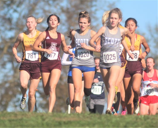 Scott teammates Dyllan Hasler, 1020, and Maddie Strong, 1025, run early in the 2A race November 2.