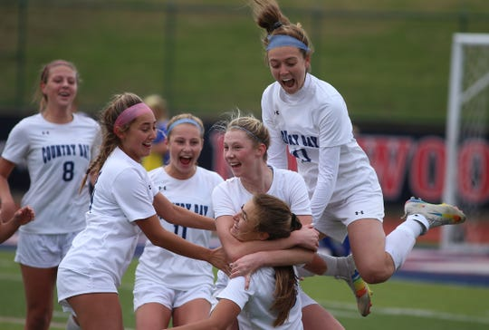 Cincinnati Country Day soccer player Lawson Renie (5) celebrates with her teammates after scoring a goal during their regional match against Mariemont, Saturday, Nov. 2, 2019.