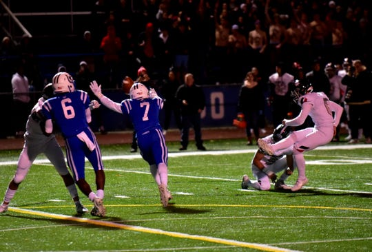 Indian Hill kicker Luke Lundberg eases a kick past the Wyoming defense for a field goal, Nov. 1, 2019.