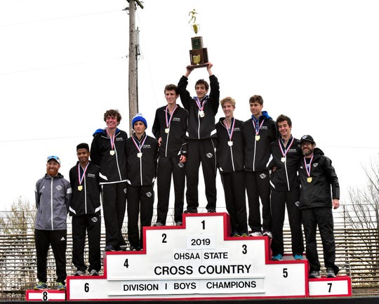 The St. Xavier Bombers hoist the Division1 team 1st place trophy at the 2019 OHSAA State Cross Country Champiionships, November 2, 2019.