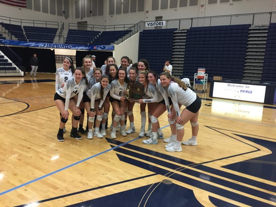 Cincinnati Hills Christian Academy Eagles pose with the program's first volleyball regional championship trophy after a win against Versailles on Saturday, Nov. 2.