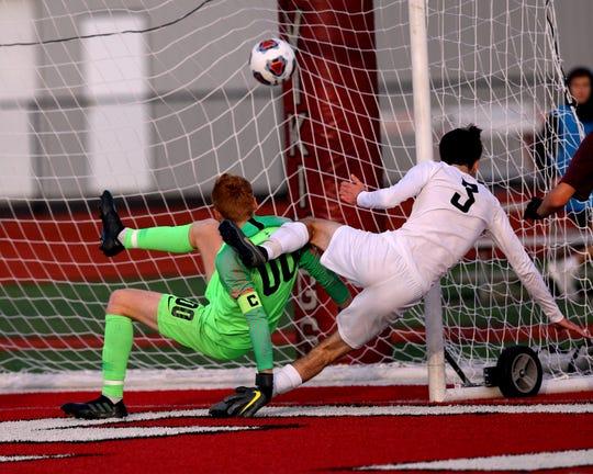 Lakota East midfielder Nolan Earl scores the winning goal against Moeller goal keeper Cal Collins in the Division 1 Boys Regional Soccer Finals at Princeton High School November 02, 2019.