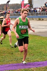 Mason's Aiden Amshoff hit the finish line with a single shoe helping lead his Comets team to the Division I boys state runner's up spot at the 2019 OHSAA State Cross Country Champiionships, November 2, 2019.
