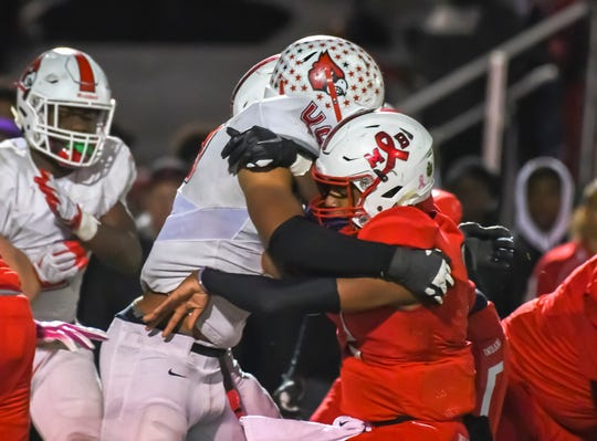 Colerain's Donovan Owens (49) tackles Sawiaha Ellis (3) of the Fairfield Indians on Friday, Nov. 1, 2019 at Kroger Stadium in Fairfield, Ohio