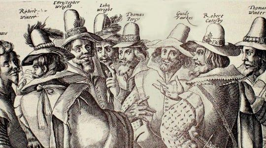 Conspirators plan the Gunpowder Plot.