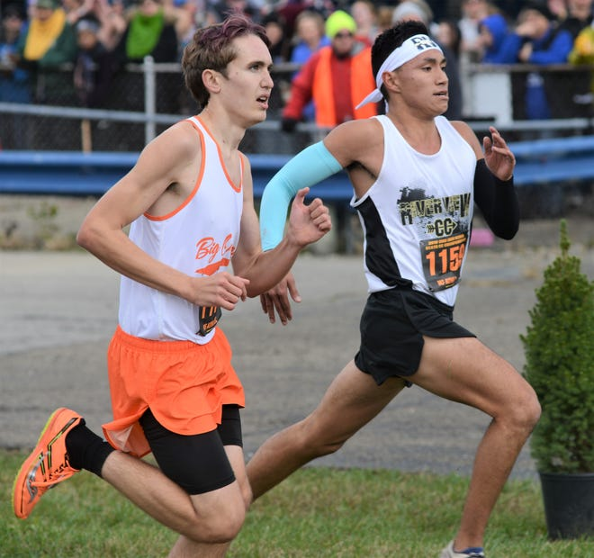 River View's Javin Robinson (right) passes a competitor down the home stretch of last season's Division II state cross country meet. Robinson finished 41st and will lead the Black Bears again this season as they join the Muskingum Valley League.