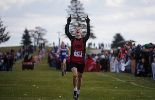 ADM junior Nate Mueller reacts after winning a Class 3A title during the 2019 Iowa high school boys and girls state cross country meet on Saturday, Nov. 2, 2019, in Fort Dodge.