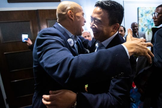Democratic presidential candidate U.S. Sen. Cory Booker, D-New Jersey, (left) is greeted by Democratic presidential candidate Andrew Yang during the 2019 Accessibility, Inclusion, and Outreach Conference, hosted by Accessibility for All and the Linn County Medical Society, Saturday, Nov., 2, 2019, at the Ramada Hotel and Conference Center in Cedar Rapids, Iowa.