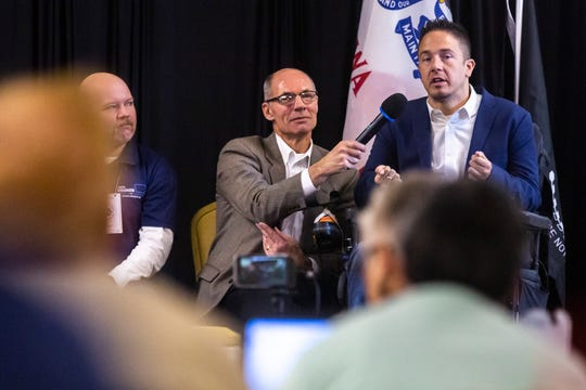 Mike Franken, a Democrat running for U.S. Senate in Iowa, holds a microphone for Sioux City city council member Alex Watters as he speaks during the 2019 Accessibility, Inclusion, and Outreach Conference, hosted by Accessibility for All and the Linn County Medical Society, Saturday, Nov., 2, 2019, at the Ramada Hotel and Conference Center in Cedar Rapids, Iowa.