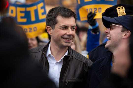 South Bend Indiana Mayor and 2020 Democratic presidential candidate Pete Buttigieg and his husband Chasten Buttigieg lead a march to the Iowa Democratic Party's 2019 Liberty and Justice Dinner on Friday, Nov. 1, 2019 in Des Moines.