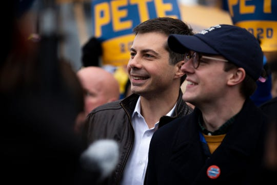 South Bend Indiana Mayor and 2020 Democratic presidential candidate Pete Buttigieg and his husband Chasten Buttigieg march with supporters before the Iowa Democratic Party's 2019 Liberty and Justice Dinner on Friday, Nov. 1, 2019 in Des Moines.