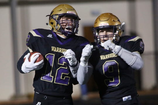 Norwalk junior receiver Ethan Carlson and senior Blake Neil celebrate Carlson's touchdown. Norwalk hosted Glenwood in the first round of the Class 3A playoffs on Nov. 1.