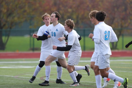 Grand Rapids Forest Hills Northern high schools Simon Scharich celebrates after his goal during the first half of Forest Hills Northern's 2-0 win in the Division 2 state final on Saturday, Nov. 2, 2019, at Novi High School.