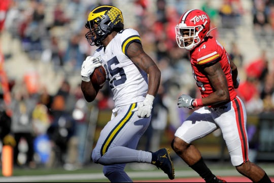 Michigan running back Hassan Haskins scores a touchdown on a run as Maryland defensive back Deon Jones tries to stop him during the second half of U-M's 38-7 win on Saturday, Nov. 2, 2019, in College Park, Md.