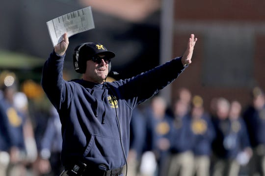 Michigan coach Jim Harbaugh gestures toward his team during the second half of U-M's 38-7 win on Saturday, Nov. 2, 2019, in College Park, Md.