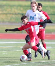 Melvindale's Alhasaan Yahya takes a shot against Grand Rapids Forest Hills Northern during the second half of Forest Hills Northern's 2-0 win in the Division 2 state final on Saturday, Nov. 2, 2019, at Novi High School.