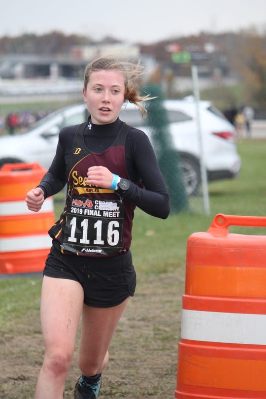 Birmingham Seaholm junior Audrey DaDamio makes the turn at the 2-mile point in the Division 1 state cross-country finals. She finished fifth in 18:08.7.