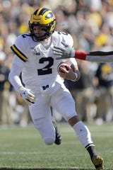 Michigan quarterback Shea Patterson runs with the ball against Maryland during the first half of an NCAA college football game, Saturday, Nov. 2, 2019, in College Park, Md.