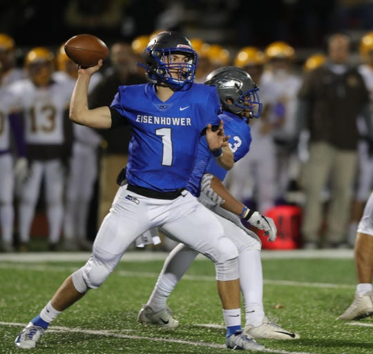 Utica Eisenhower QB Blake Rastigue threw for three touchdowns in Ike's 24-0 win over Rochester Adams.