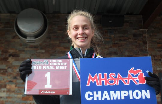 Muskegon Western Michigan Christian sophomore Abby VanderKooi won her second straight Division 4 cross-country championship by a wide margin, finishing 71 seconds ahead of runner-up Riley Ford of Marlette.