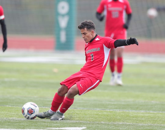 Melvindale's Zaid Ahmed takes a shot against Grand Rapids Forest Hills Northern high school during the first half of Forest Hills Northern's 2-0 win in the Division 2 state final on Saturday, Nov. 2, 2019, at Novi High School.