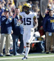Michigan's Giles Jackson returns the opening kickoff for a touchdown during the first half of an NCAA college football game against Maryland, Saturday, Nov. 2, 2019, in College Park, Md.