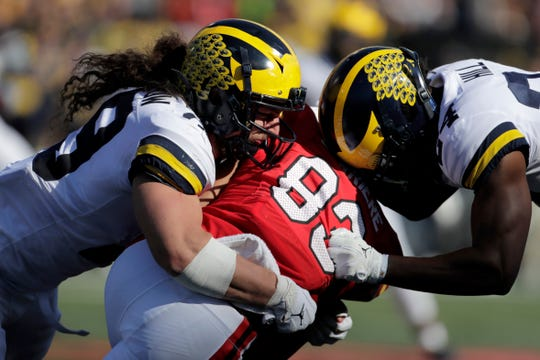 Maryland wide receiver Carlos Carriere, center, is tackled by Michigan linebacker Jordan Glasgow, left, and defensive back Lavert Hill during the second half of U-M's 38-7 win on Saturday, Nov. 2, 2019, in College Park, Md.