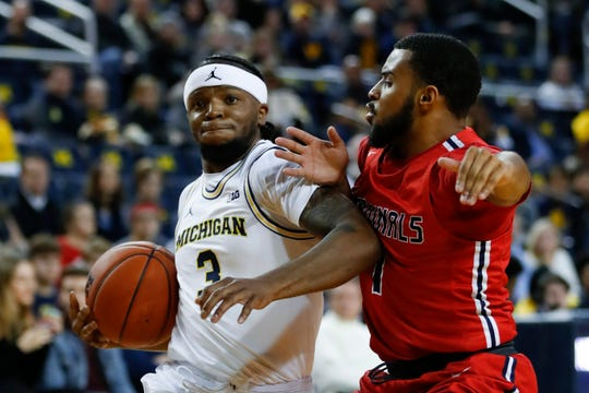 Michigan guard Zavier Simpson (3) drives on Saginaw Valley State's Malik Ellison (1) during the first half of an NCAA exhibition college basketball game in Ann Arbor, Mich., Friday, Nov. 1, 2019.