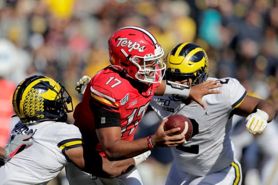 Maryland quarterback Josh Jackson is tackled by Michigan linebacker Khaleke Hudson, left, and defensive lineman Carlo Kemp during the second half of U-M's 38-7 win on Saturday, Nov. 2, 2019, in College Park, Md.