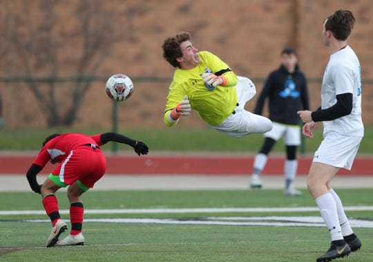 Grand Rapids Forest Hills Northern's Carter Clark makes a save during the second half of Forest Hills Northern's 2-0 win in the Division 2 state final on Saturday, Nov. 2, 2019, at Novi High School.
