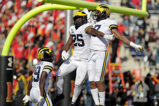 Michigan running back Hassan Haskins, center, celebrates his touchdown run against Maryland with wide receivers Tarik Black, right, and Mike Sainristil during the second half of U-M's 38-7 win on Saturday, Nov. 2, 2019, in College Park, Md.