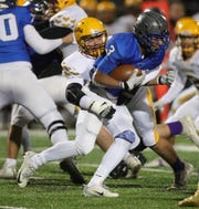 Utica Eisenhower's Mario Getaw had Ike's final touchdown on Friday night against Rochester Adams.