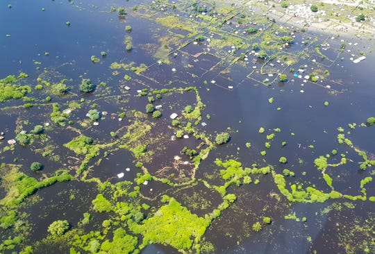 In this photo taken Sunday, Oct. 20, 2019 and released by Medecins Sans Frontieres, areas are submerged by floodwaters between Bor and Pibor, seen from the air, in South Sudan.