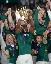 South African captain Siya Kolisi holds the Webb Ellis Cup aloft after South Africa defeated England to win the Rugby World Cup final Saturday at International Yokohama Stadium in Yokohama, Japan.