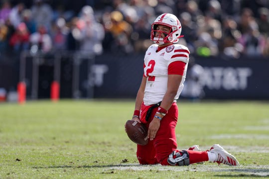 Nebraska quarterback Adrian Martinez (2) falls to his knees after failing to pick up a first down.