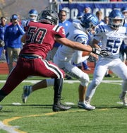 Justin Mundt of Elmira pressures Horseheads quarterback Grayson Woodhouse during a Section 4 Class AA semifinal Nov. 2, 2019 at Ernie Davis Academy.