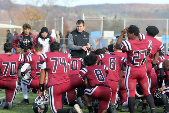 Elmira head coach Jimmy McCauley talks to his players after a 28-12 win over Horseheads in a Section 4 Class AA semifinal Nov. 2, 2019 at Ernie Davis Academy.