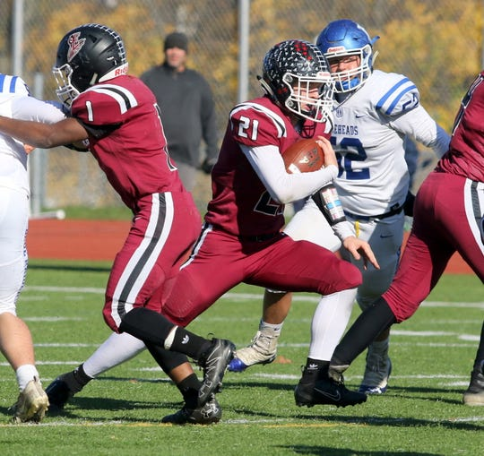 Nate Latshaw of Elmira carries the ball against Horseheads in a Section 4 Class AA semifinal Nov. 2, 2019 at Ernie Davis Academy.