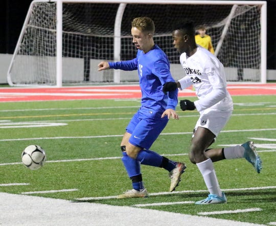 Horseheads' Kyle Loeber, left, and Corning's Preston Ogunwumi chase the ball during the Section 4 Class AA boys soccer final Nov. 1, 2019 at Waverly Memorial Stadium.