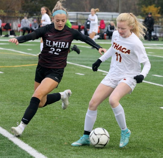 Elmira's McKenna Ross (22) and Ithaca's Beth Duncan battle for possession in the Section 4 Class AA girls soccer final Nov. 1, 2019 at Waverly Memorial Stadium.